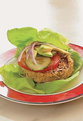 A photo of a raw food burger