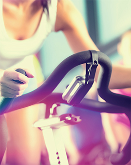 A photo of a woman on an exercise bike