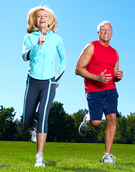 An elderly couple jogging