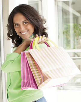 A photo of a woman with shopping bags