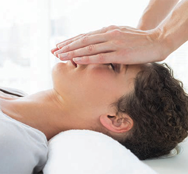 A photo of a Reiki master at work