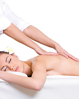 A photo of a woman being massaged