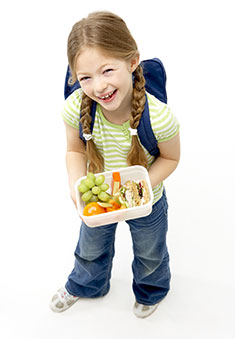 A photo of a girl with a lunchbox